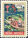 A boat with a boy sitting and girl picking lotus flowers